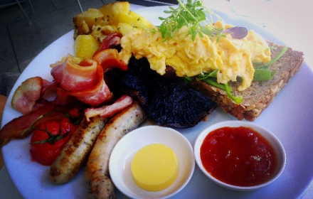 Big breakfast, eggs, bacon, chicken & herb sausages, agria hash, field mushrooms,  vine ripened tomatoes, chutney